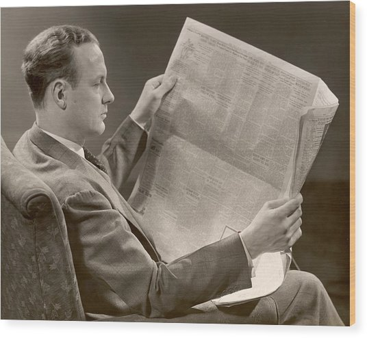 A Man Reads A Newspaper Wood Print by George Marks