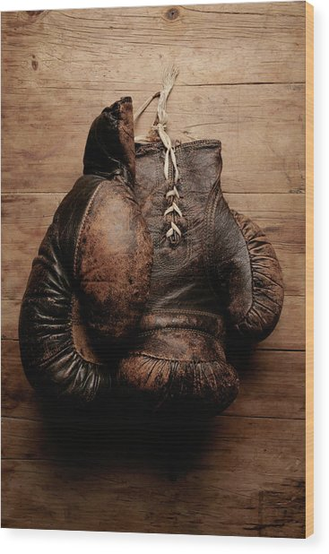 A Pair Of Worn Old Boxing Gloves On Wood Print by The flying dutchman