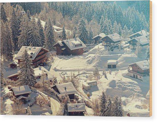 A Quaint Village In The Swiss Alps Wood Print by Saphotog