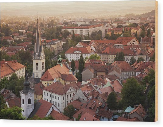 Aerial View Of Church And Rooftops Wood Print by Cultura Rf/lost Horizon Images