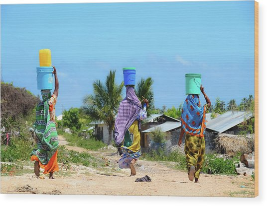African Women Go To Fetch Water W Wood Print by Volanthevist