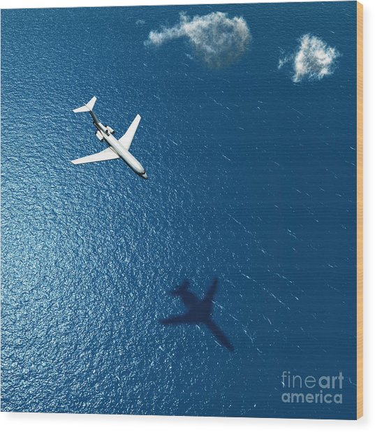 Airplane Flies Over A Sea Wood Print