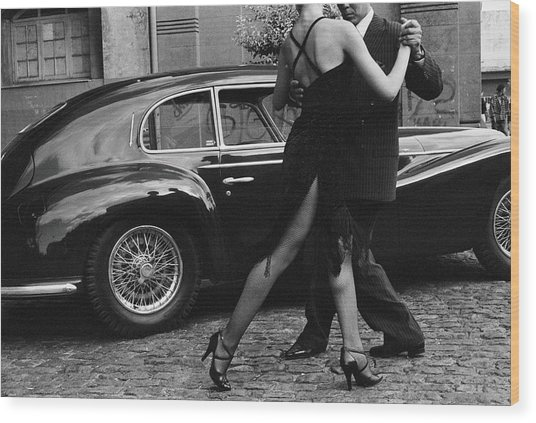 Argentina, Couple Dancing Tango By Car Wood Print by Christopher Pillitz