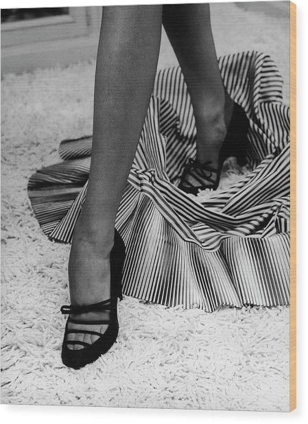 Artful Shot Of Model Showing Off A Pair Wood Print by Nina Leen