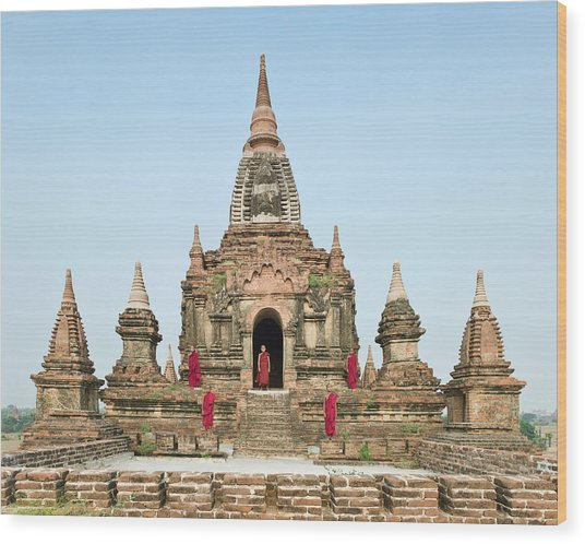 Bagan,buddhist Monks Standing On Temple Wood Print by Martin Puddy