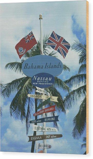 Bahamas Signpost Wood Print by Slim Aarons