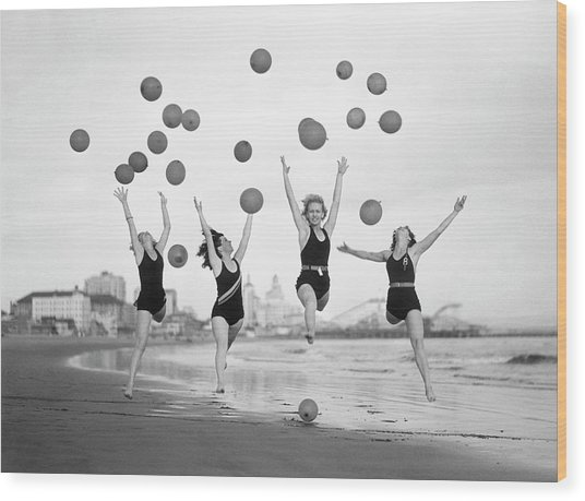 Balloon Dancers On Long Beach Wood Print by Bettmann