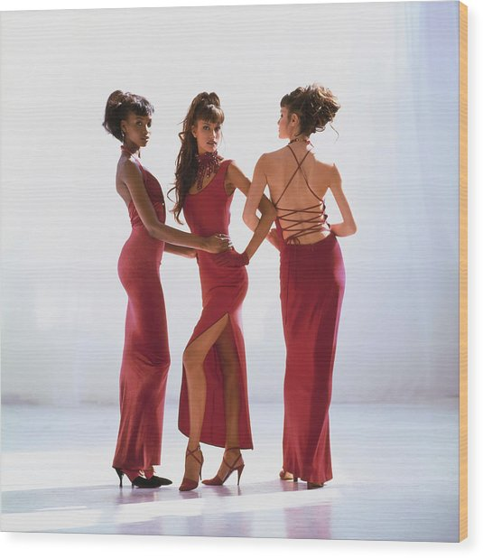 Beverly Peele, Susan Holmes, And Claudia Mason In Red Dresses Wood Print by Arthur Elgort