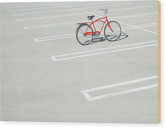 Bike In Empty Parking Lot Wood Print by Peter Starman