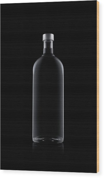 Bottle Of Water Isolated On Black Wood Print