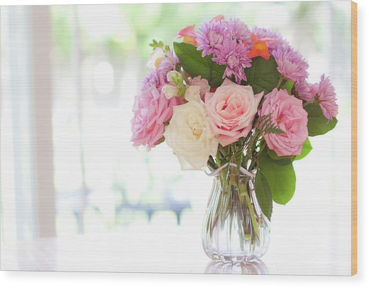 Bouquet Of Flowers On Table Near Window Wood Print