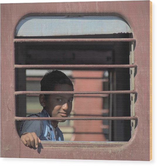 Boy On A Train Wood Print