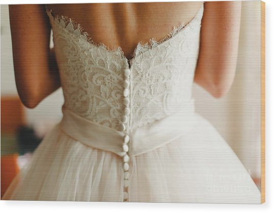 Bride Getting Ready, They Help Her By Buttoning The Buttons On The Back Of Her Dress. Wood Print