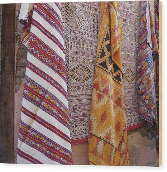 Bright Colored Patterns On Throw Rugs In The Medina Bazaar  Wood Print