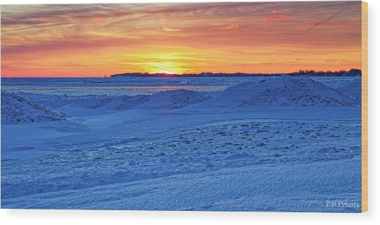 Bright Sunset Over Frozen Waves Wood Print