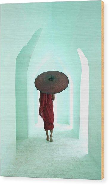 Buddhist Monk Walking Along Arched Wood Print
