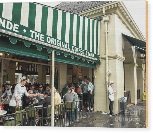 Cafe Du Monde Situation In New Orleans Wood Print by John Rizzuto