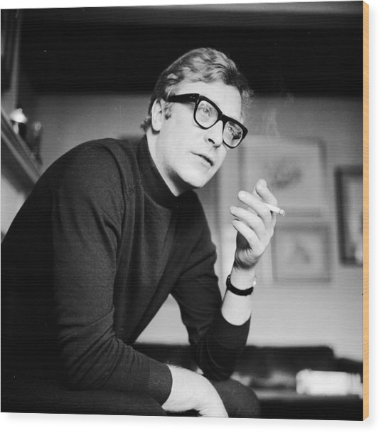 Caine Smoking Wood Print by Evening Standard