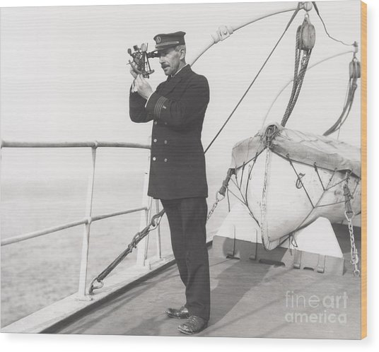 Captain Navigating Ship Wood Print