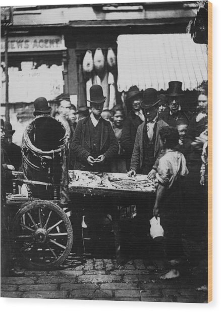 Carneys Fish Stall Wood Print by Hulton Archive