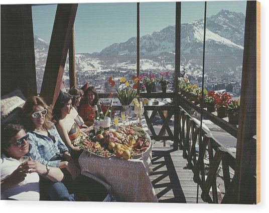 Catching The Sun In Cortina Wood Print by Slim Aarons