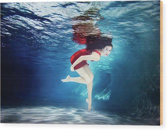 Caucasian Woman In Dress Swimming Under Wood Print