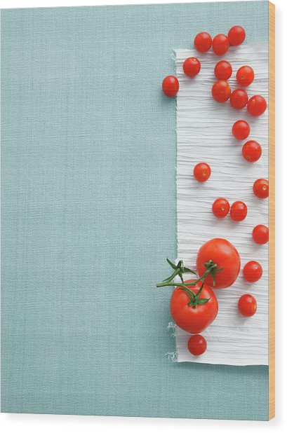 Cherry And Vine Tomatoes On Table Wood Print