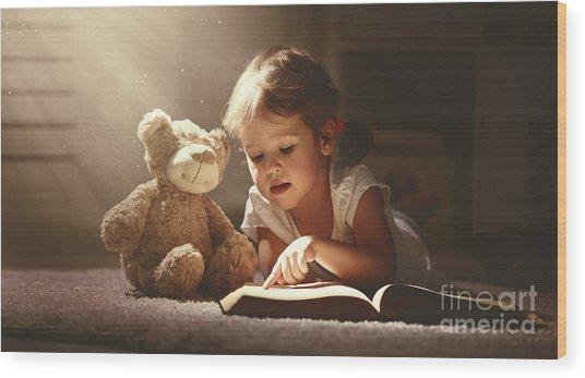 Child Little Girl Reading A Magic Book Wood Print