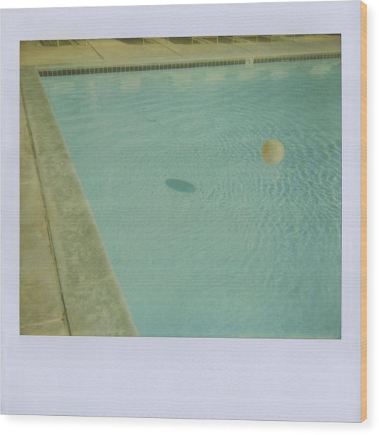Childs Inflatable Ball Floating In Wood Print by Jena Ardell