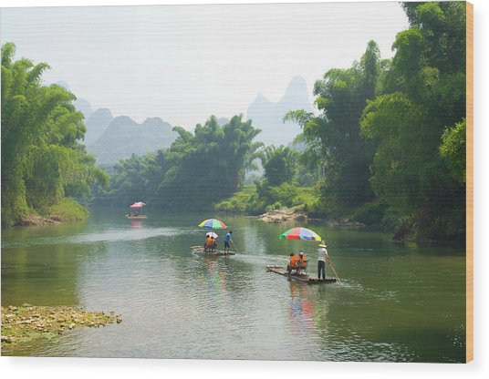 Chinese Tourists In Bamboo Rafts At Wood Print