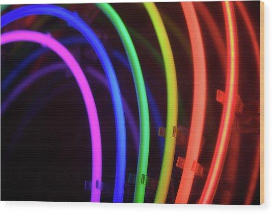 Circles Of Neon Rainbow Light Wood Print by Peskymonkey