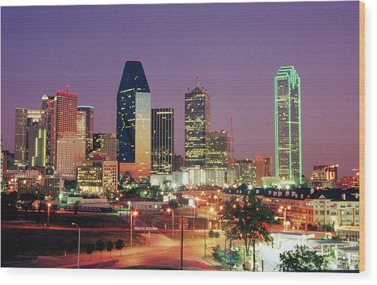77e503c31c0 City Skyline Illuminated At Dusk Wood Print