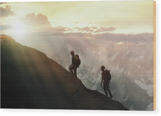 Climbers On A Mountain Ridge Wood Print by Buena Vista Images