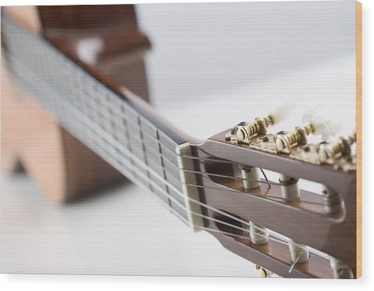 Close-up Of A Guitar Wood Print by Jamie Grill