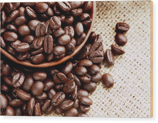 Coffee Beans Spilling From Wooden Bowl Wood Print by Joseph Clark