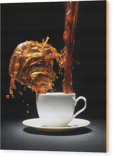Coffee Being Poured Into Cup Splashing Wood Print