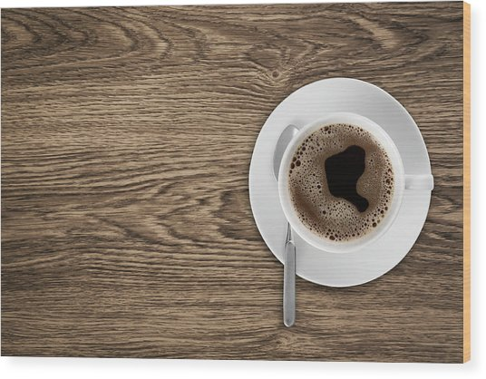 Coffeecup With Coffee In It On A Wooden Wood Print