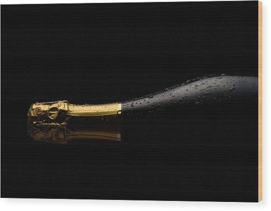 Cold Champagne Bottle Wood Print by P1images