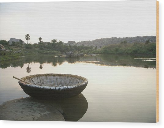 Coracle At The Bank Of A River Wood Print by Exotica.im