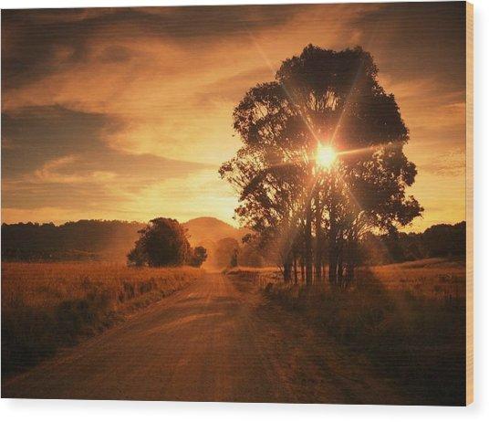Country Road Against Cloudy Sky At Wood Print by Glenn Homann / Eyeem