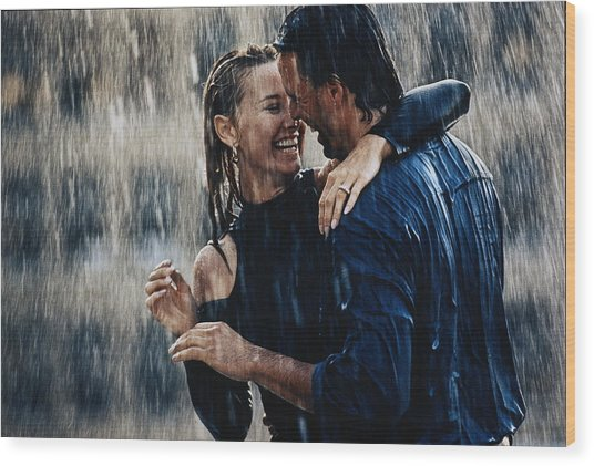 Couple Embracing In Pouring Rain Wood Print