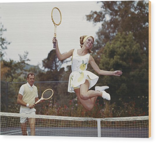 Couple On Tennis Court, Woman Jumping Wood Print