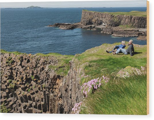 Couple Relaxing In Grass On Cliff Wood Print