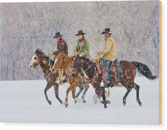 Cowboys And Cowgirl Riding Snowfall Wood Print by Danita Delimont