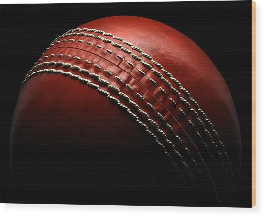 Cricket Ball On Black Background Wood Print by Ian Mckinnell