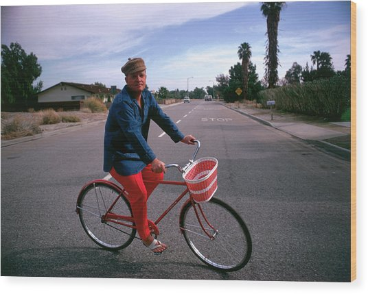 Cycling Capote Wood Print by Slim Aarons