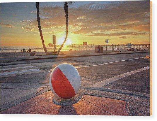 Decorative Beach Ball At Oceanside Pier Wood Print
