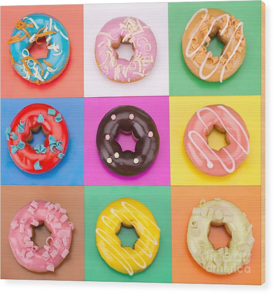 Delicious Donuts Isolated On Colorful Wood Print