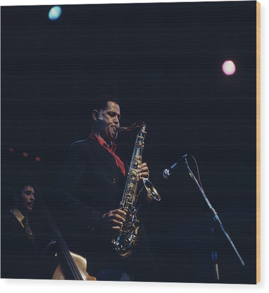Dexter Gordon Performs On Stage Wood Print by David Redfern