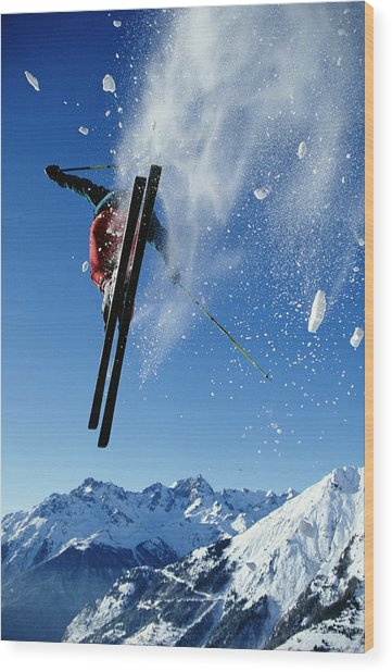 Downhill Skier In Mid-air, Rear View Wood Print